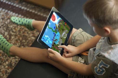 Child using a proprietary play therapy app.